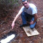 Omar Helms with cast of a Bigfoot footprint in Florida.